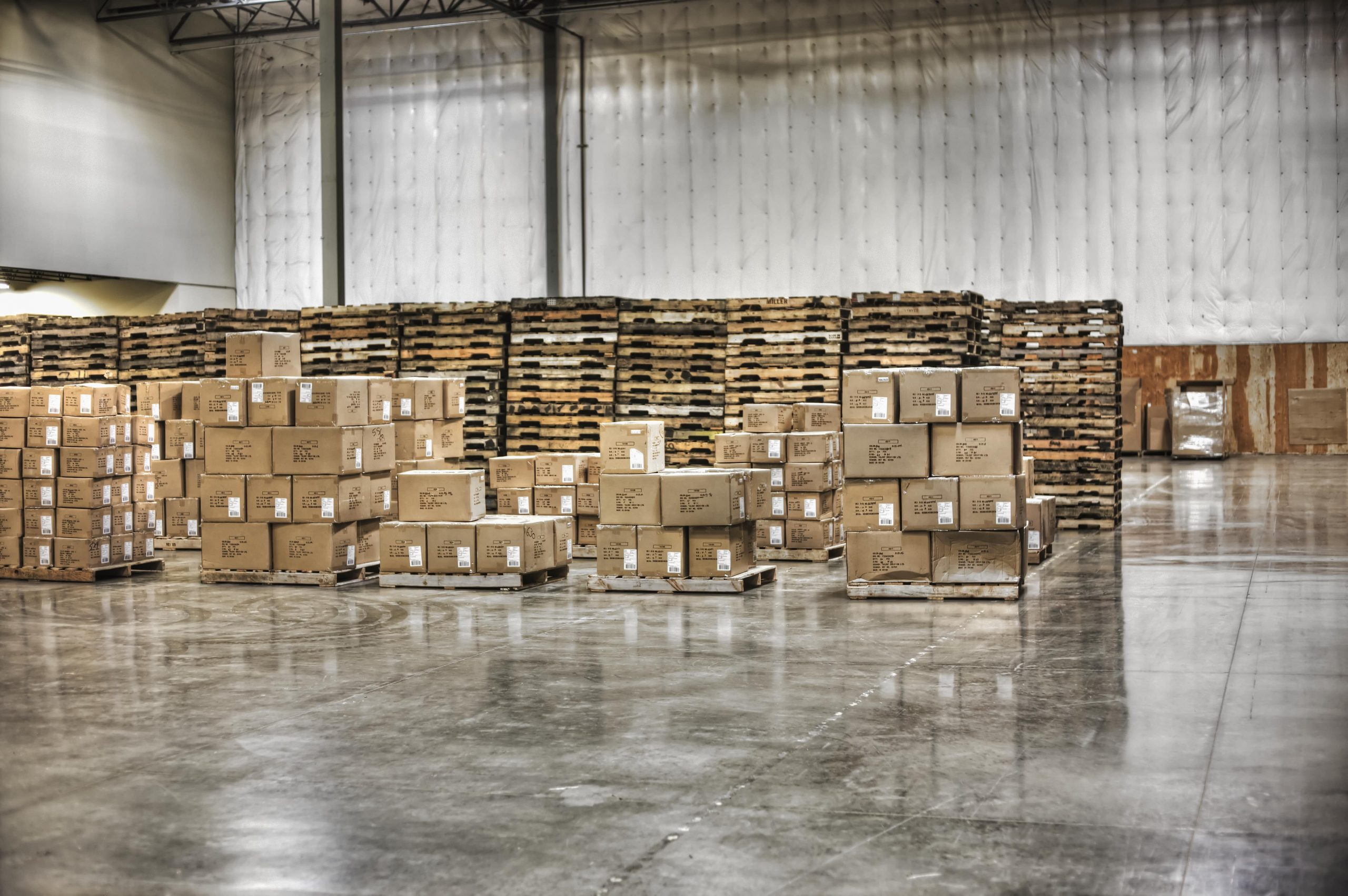 cardboard-boxes-and-pallets-in-warehouse-WG8D3XB-min