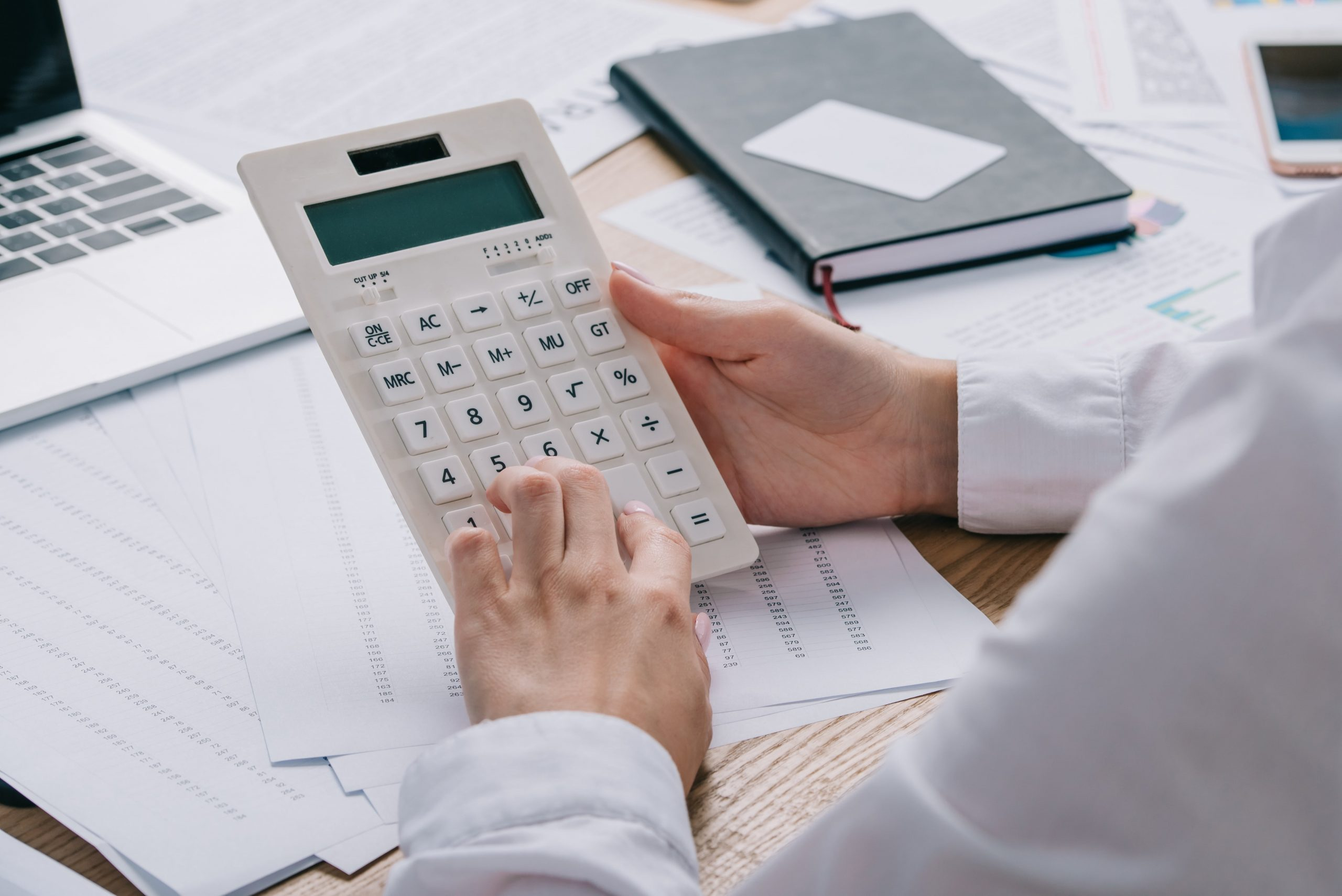 cropped-shot-of-businesswoman-making-calculations–EC4EBVH-min