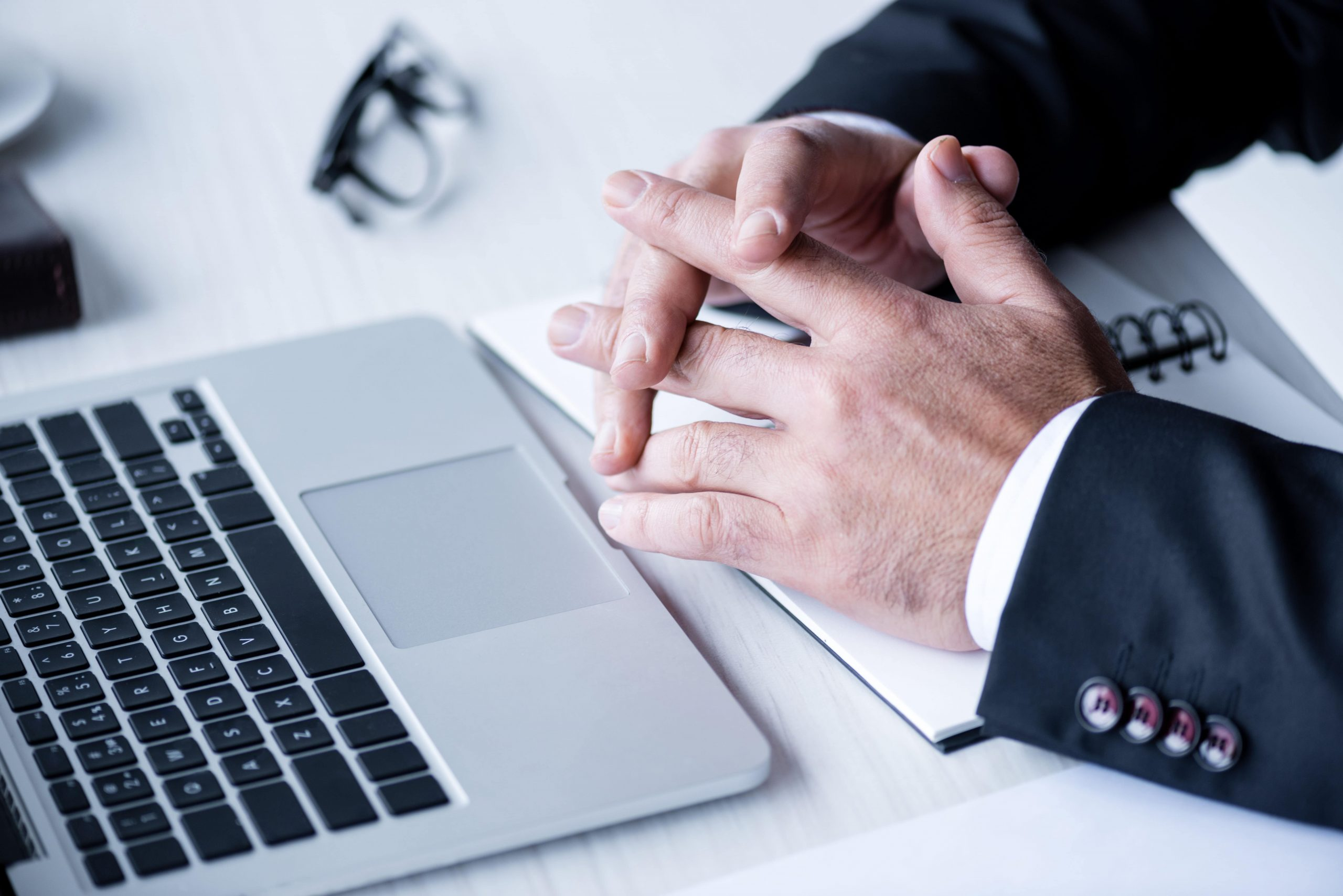cropped-view-of-businessman-in-suit-working-with-l-KA8RGN7-min