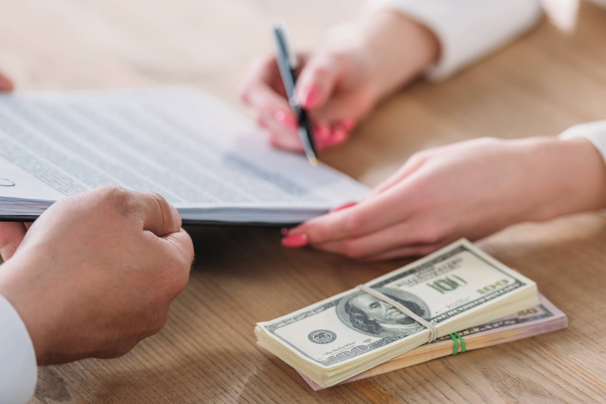 cropped-view-of-woman-signing-loan-agreement-on-cl-ZVXTZSE (1)