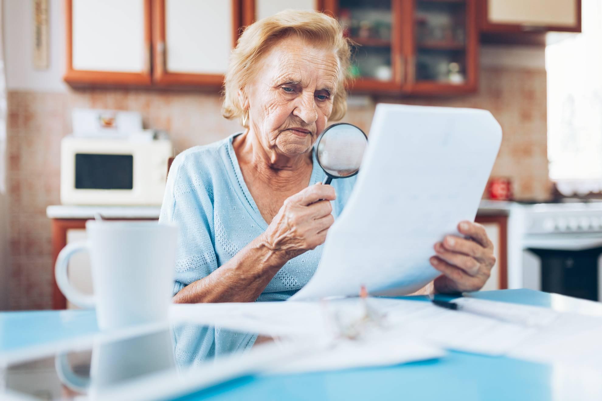 elderly-woman-looking-at-her-utility-bills-67AYR2L (1)