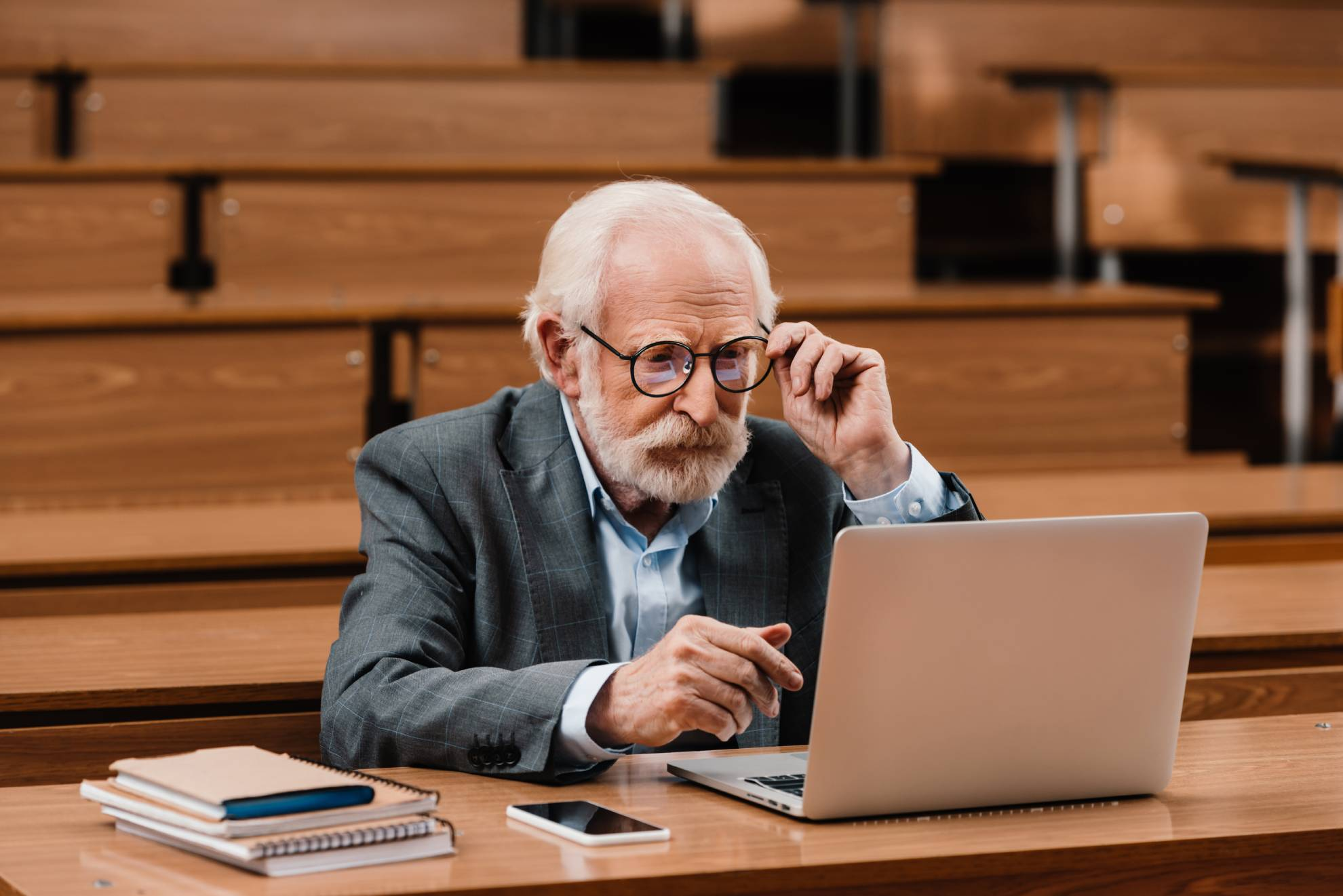 grey-hair-professor-looking-at-laptop-N6D95GT (2)