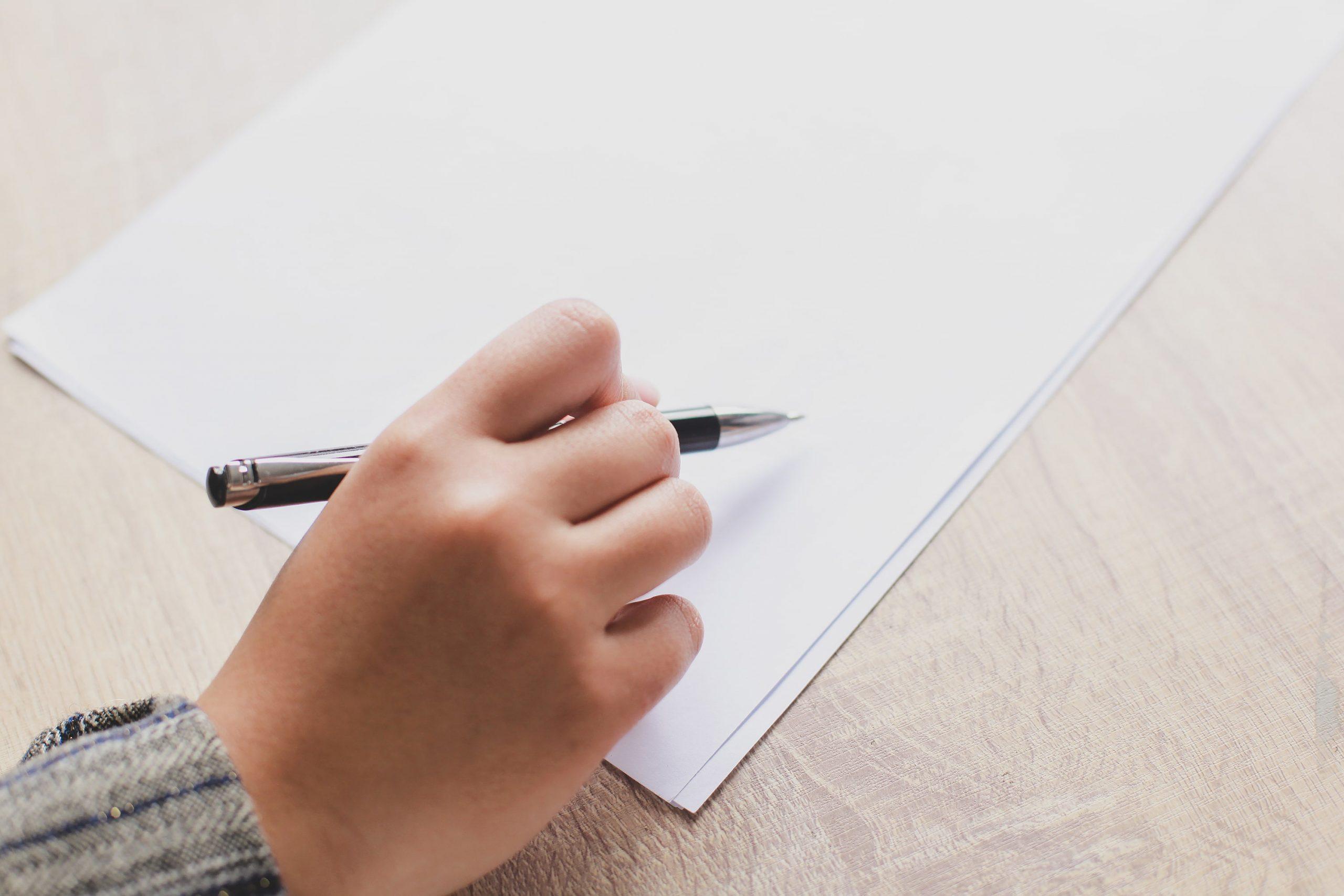 hand-writing-on-blank-paper-KHZNLQB-min