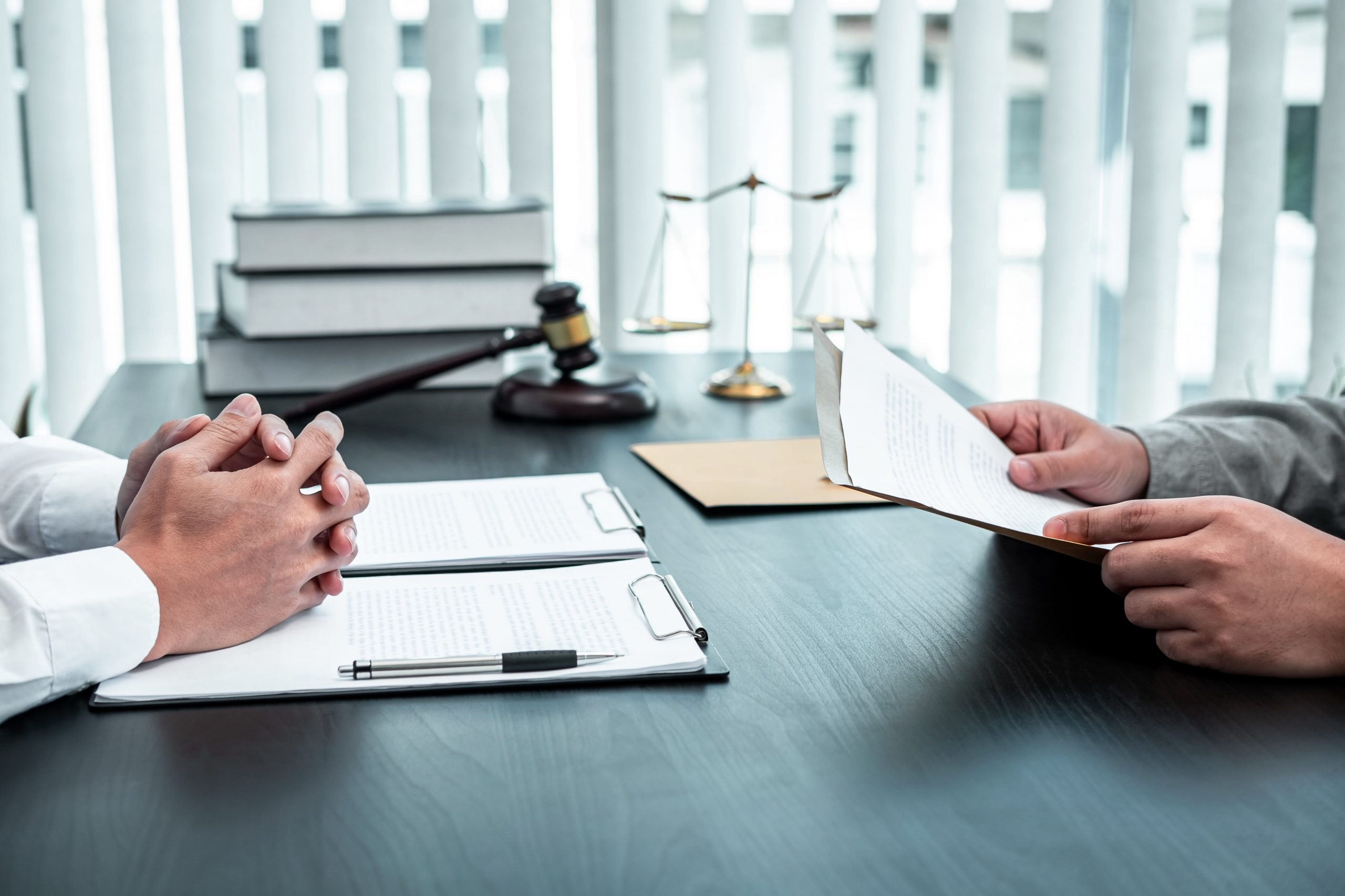male-lawyer-discussing-negotiation-legal-case-with-XYZK2XF-min