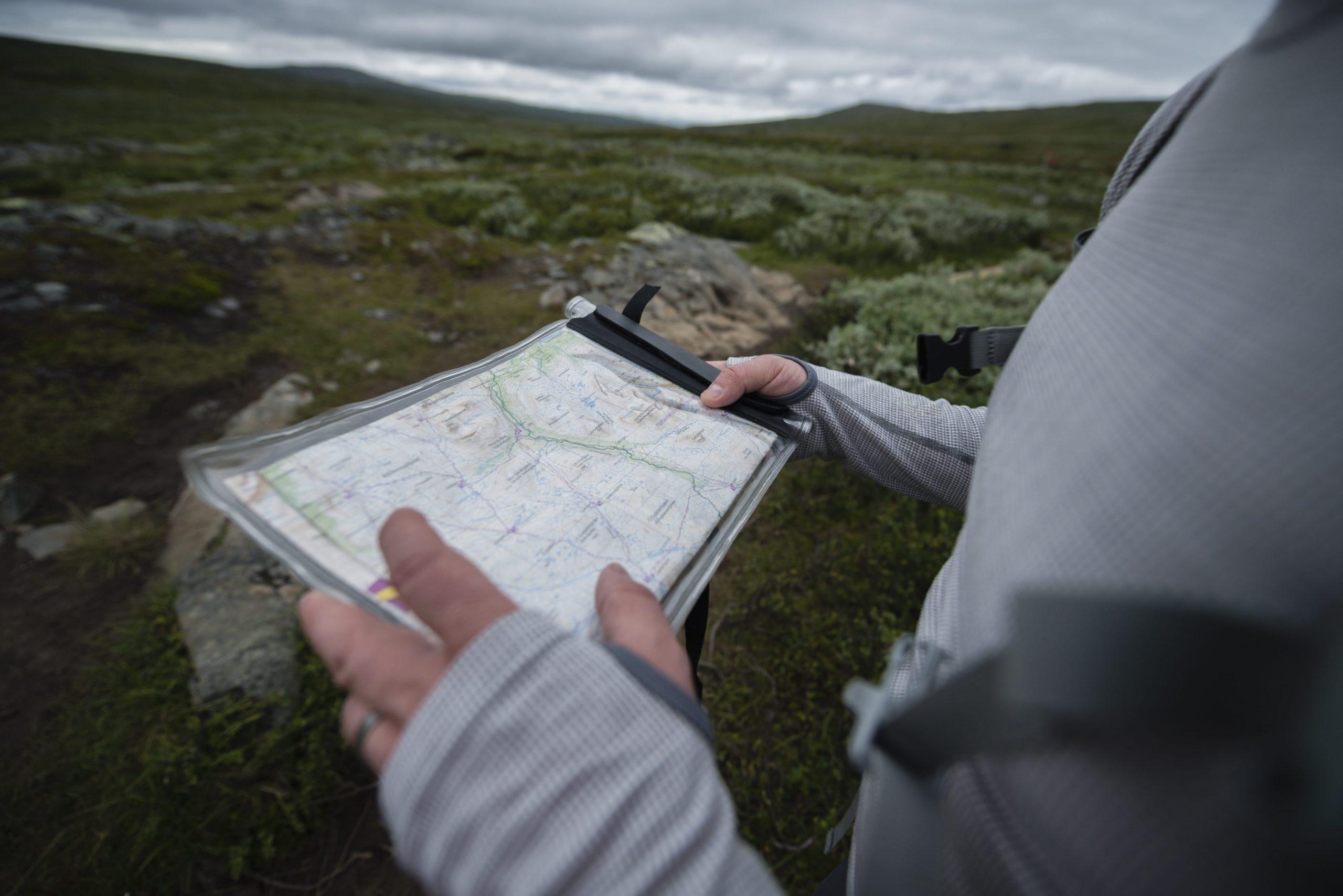 man-holding-map-XHAZ8CL-min