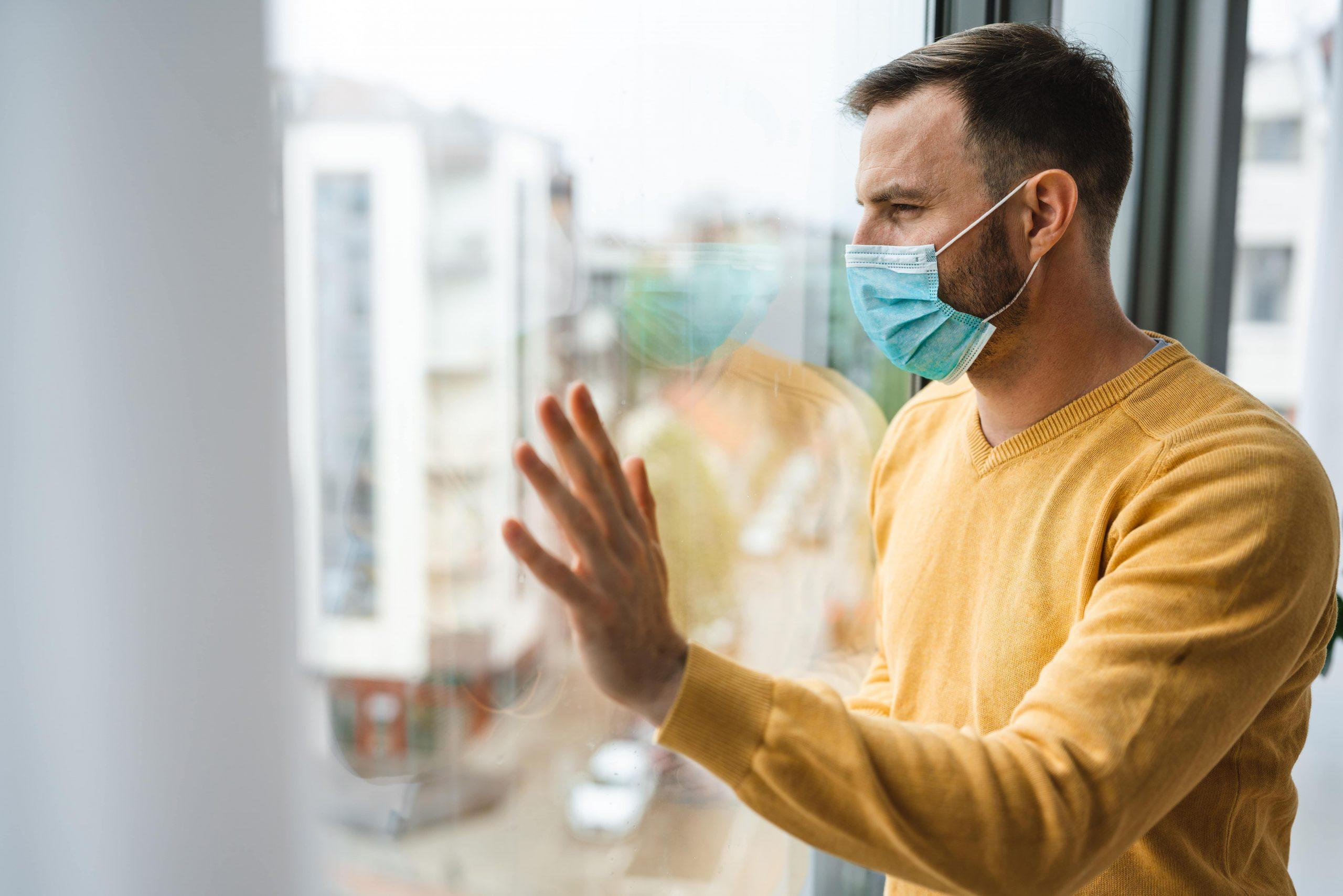 man-with-mask-to-protect-him-from-coronavirus-quar-ZUUTPPH-min