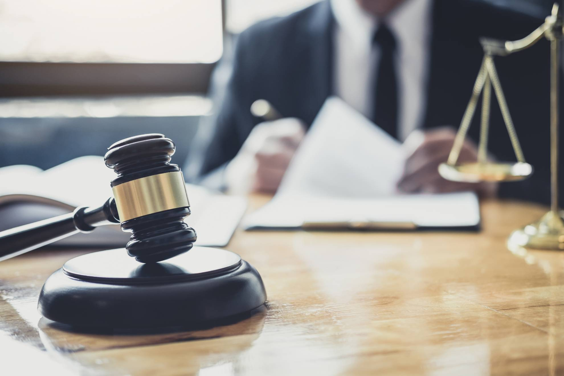 professional-male-lawyer-or-judge-working-with-con-Z7J6BQX (1)