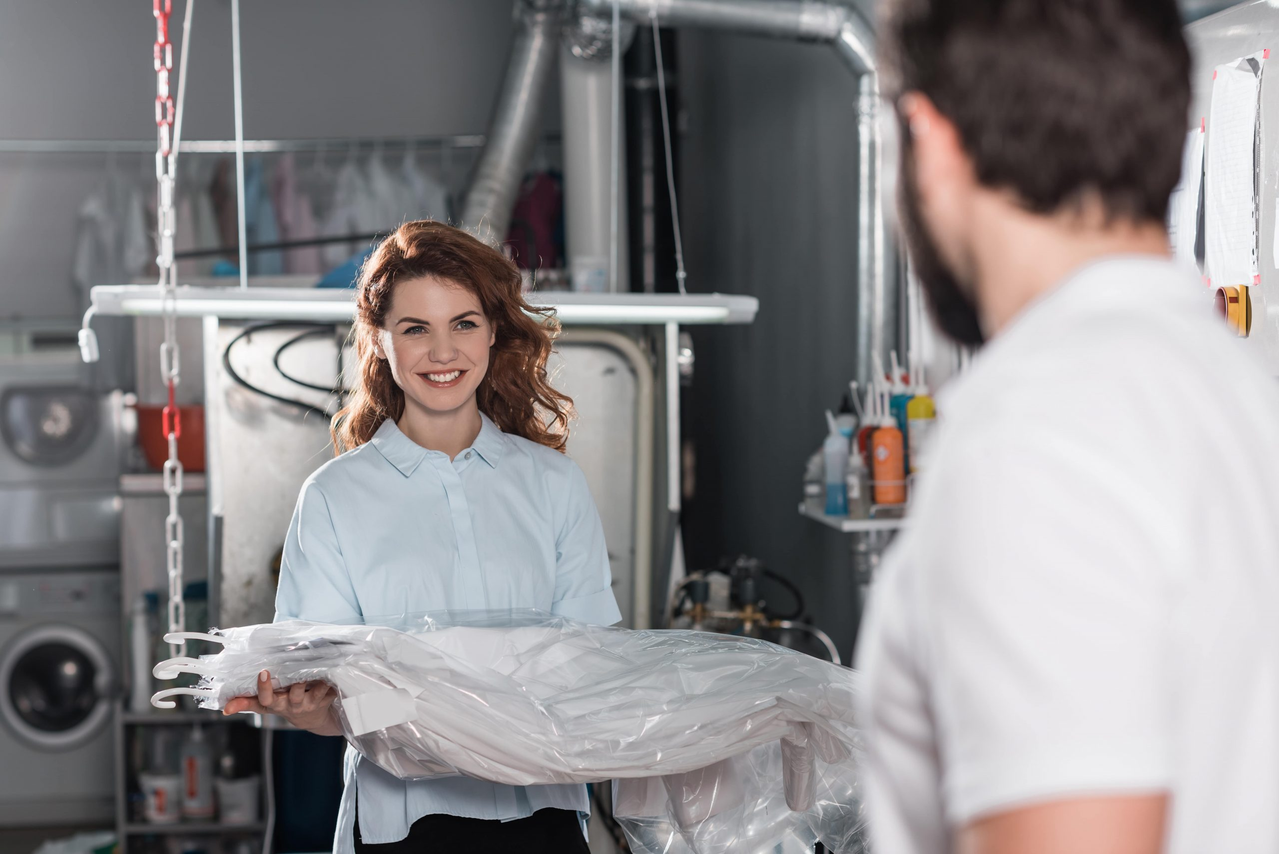 smiling-young-dry-cleaning-workers-at-warehouse-75JBAKP-min
