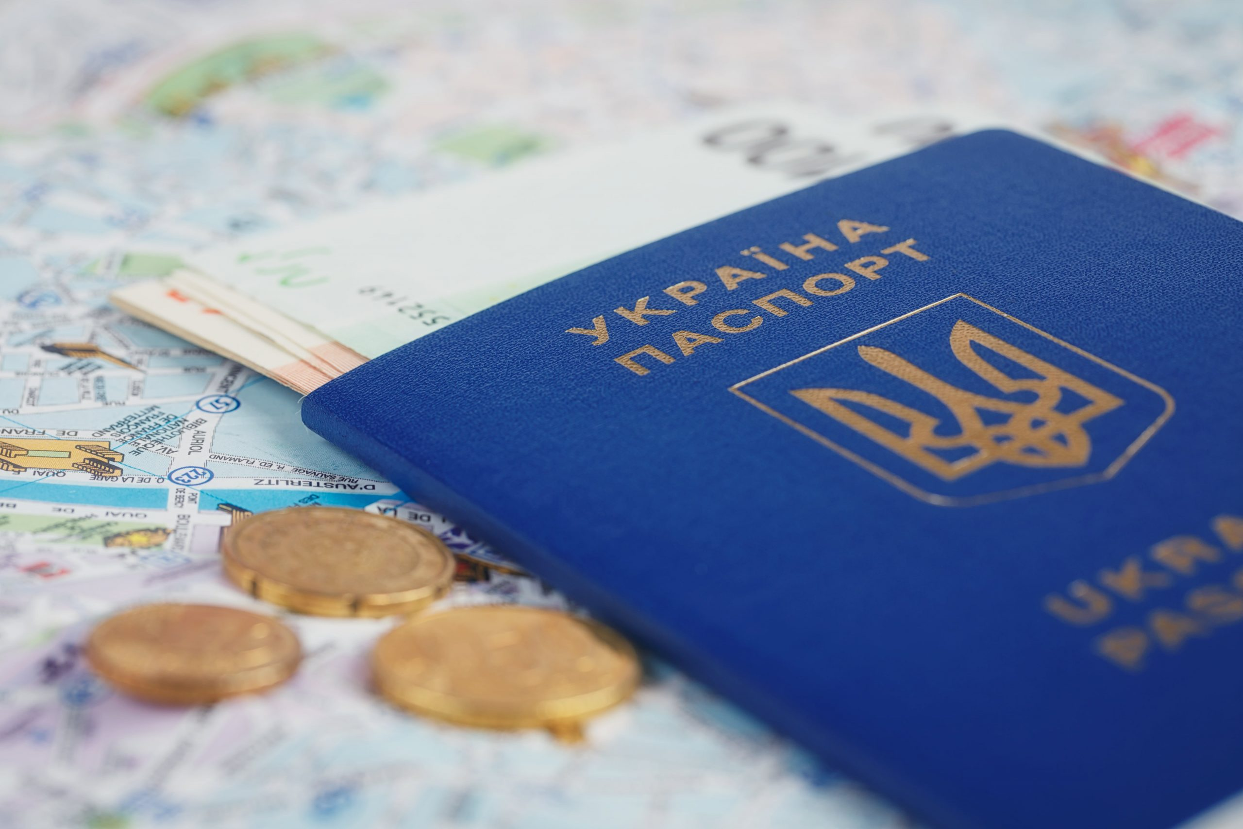 ukrainian-passport-and-money-on-map-UKVZ4YH-min