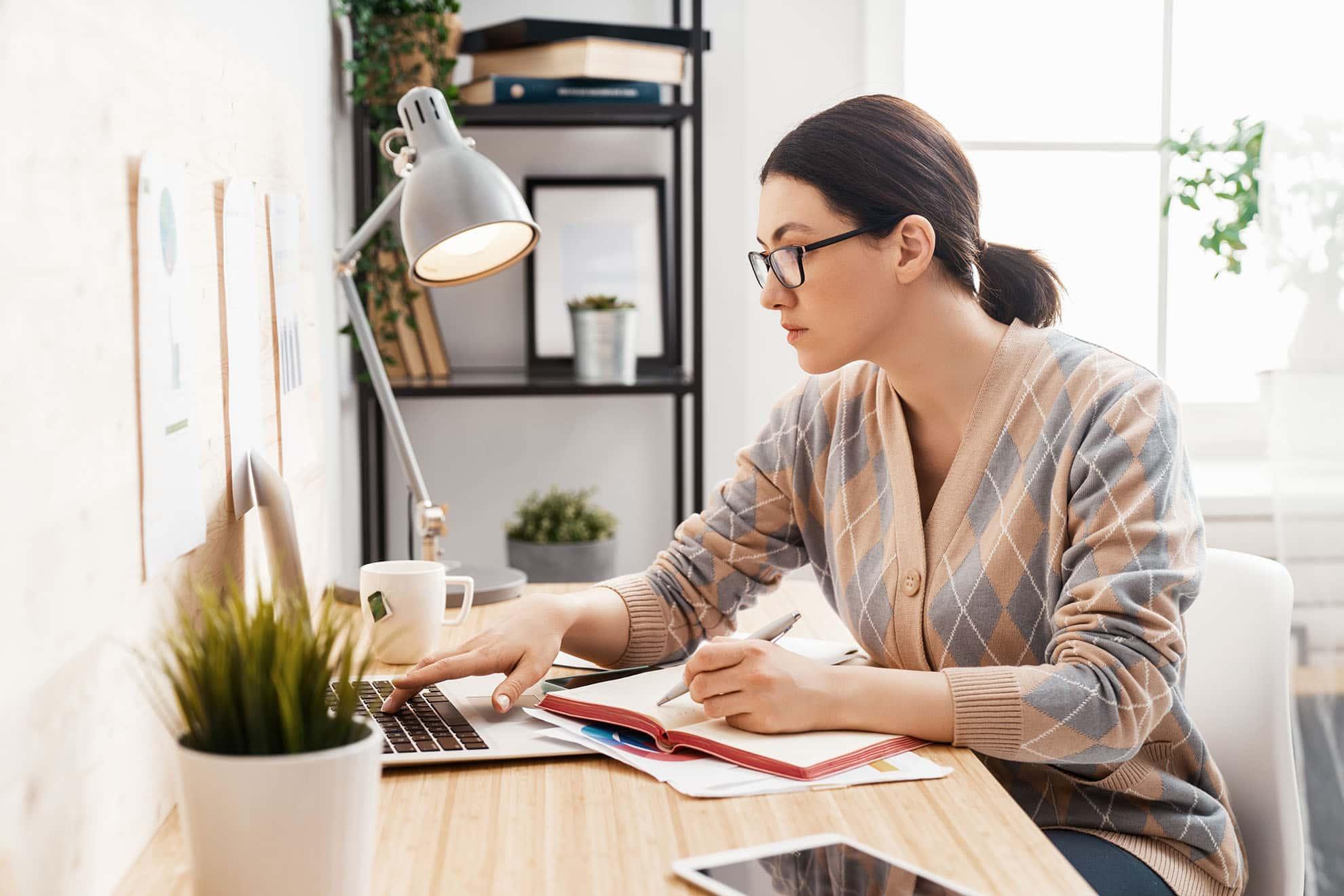 woman-working-on-a-laptop-at-home-KS5KFLT-min