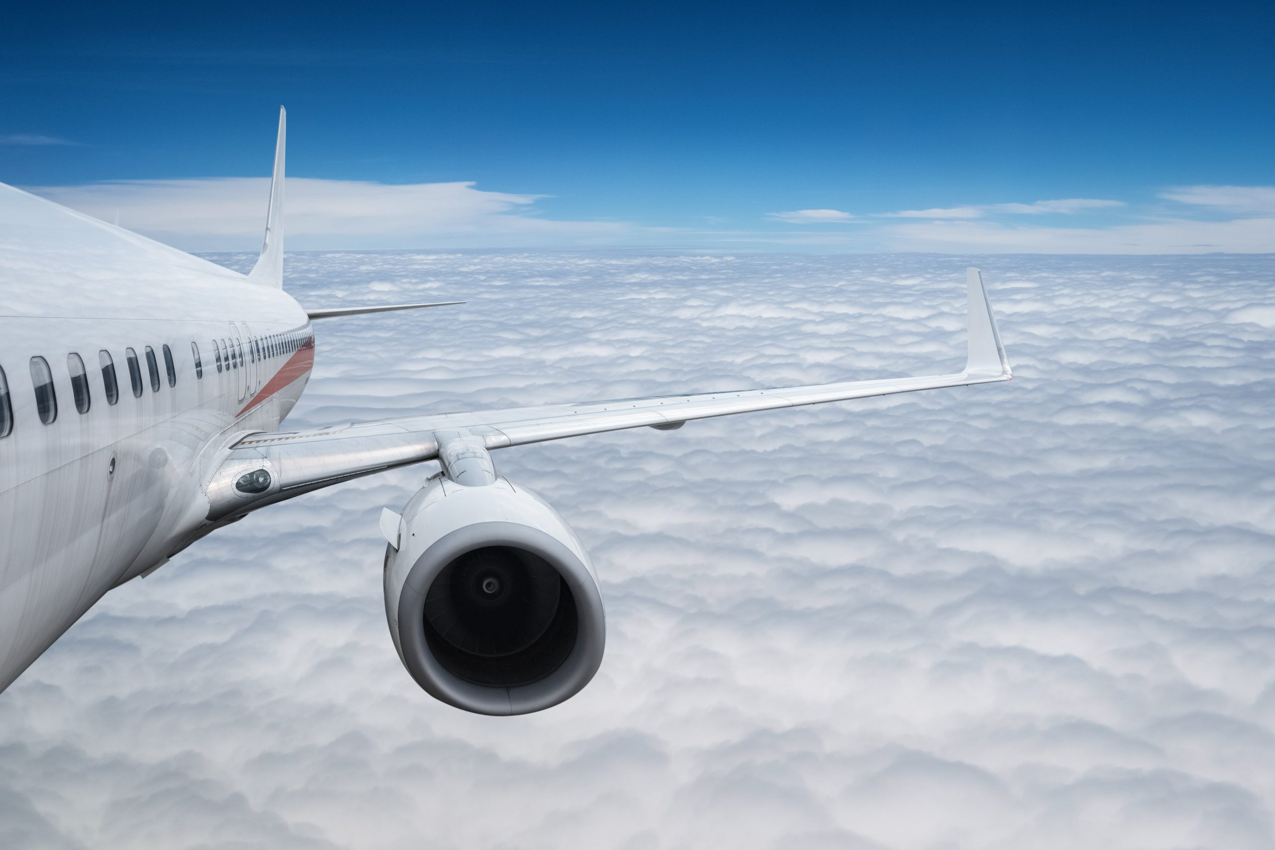 airplane-above-the-clouds-8YUZKY9