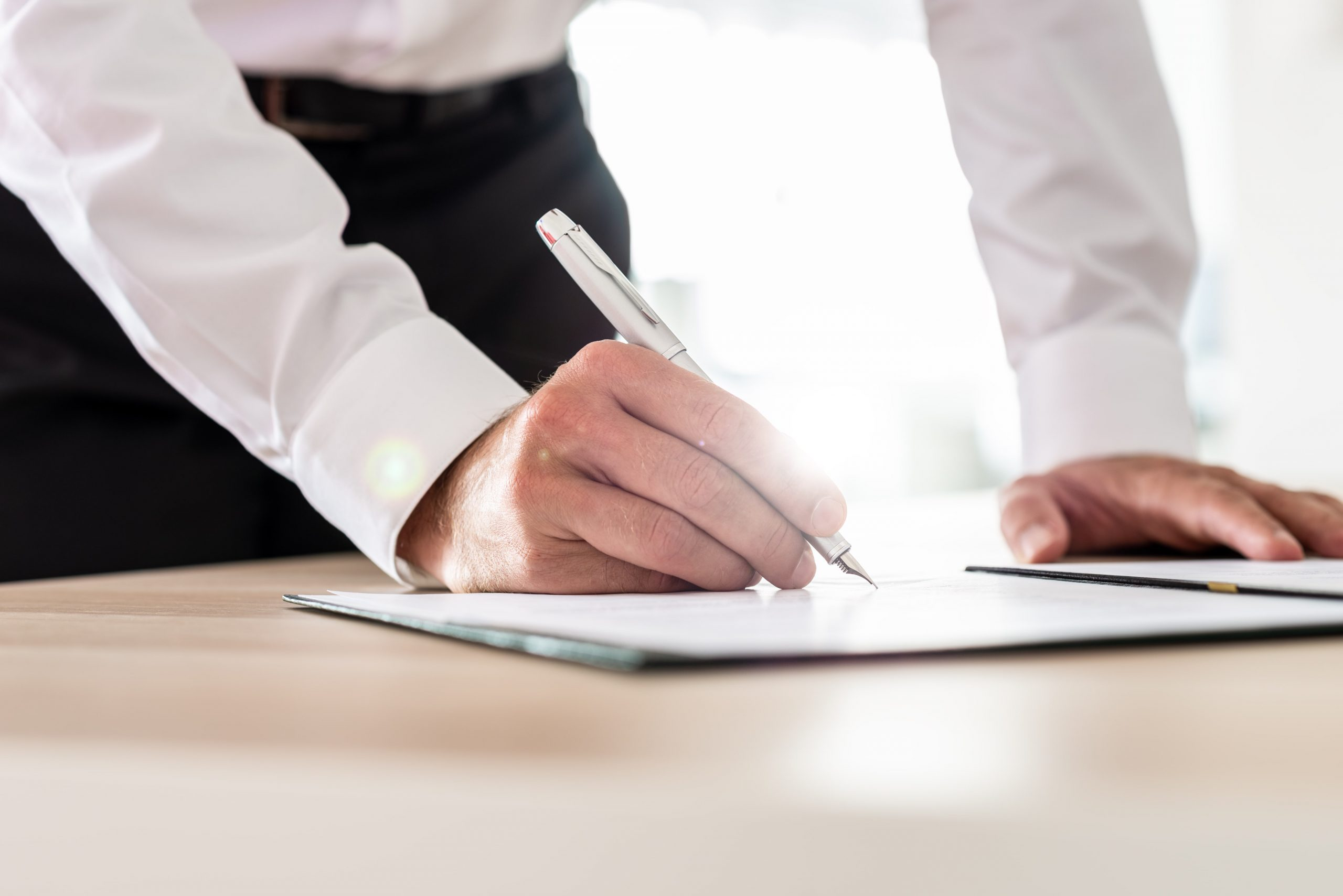 business-executive-signing-a-contract-B3GBCQF