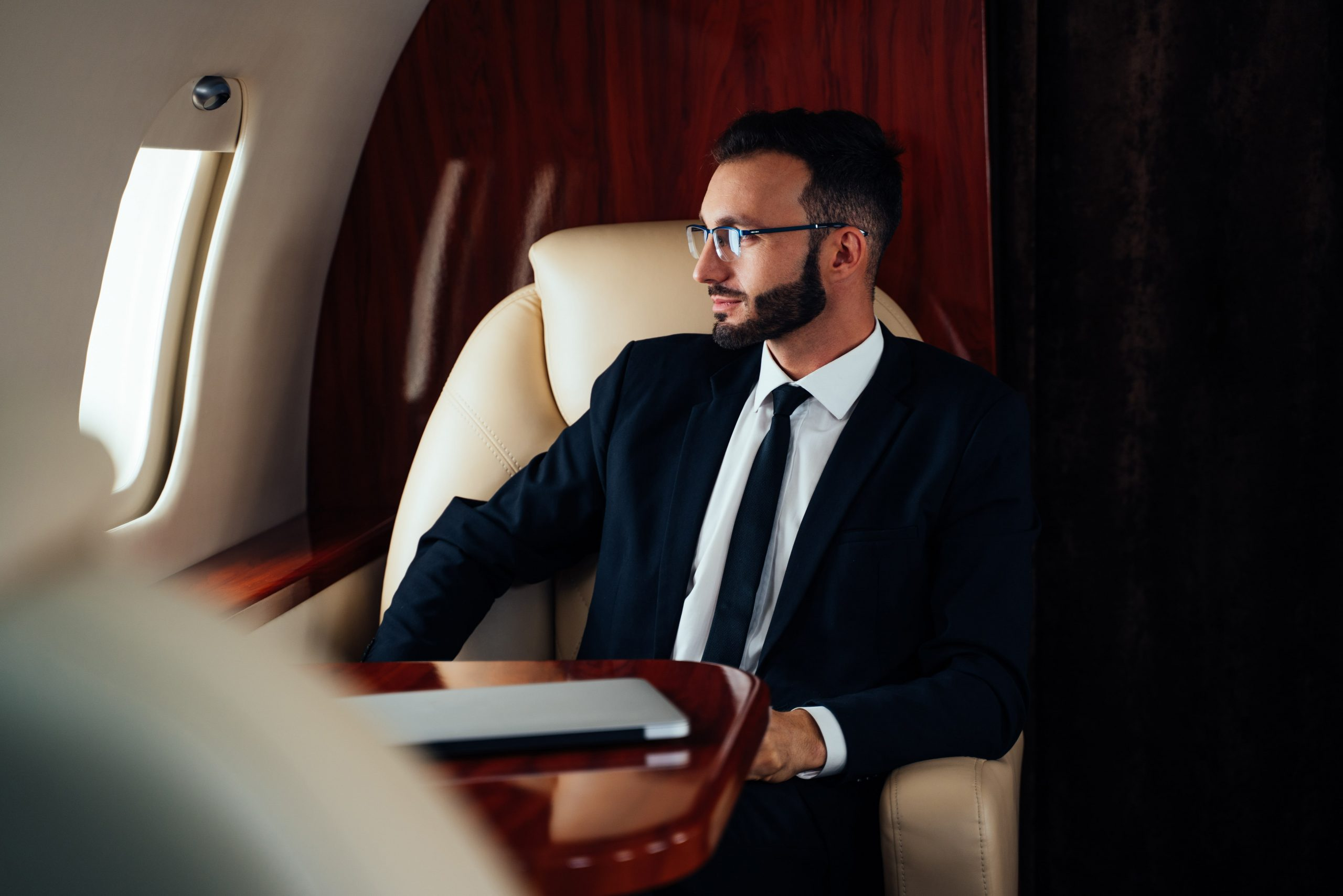 business-man-flying-on-private-jet-N3AUWJF