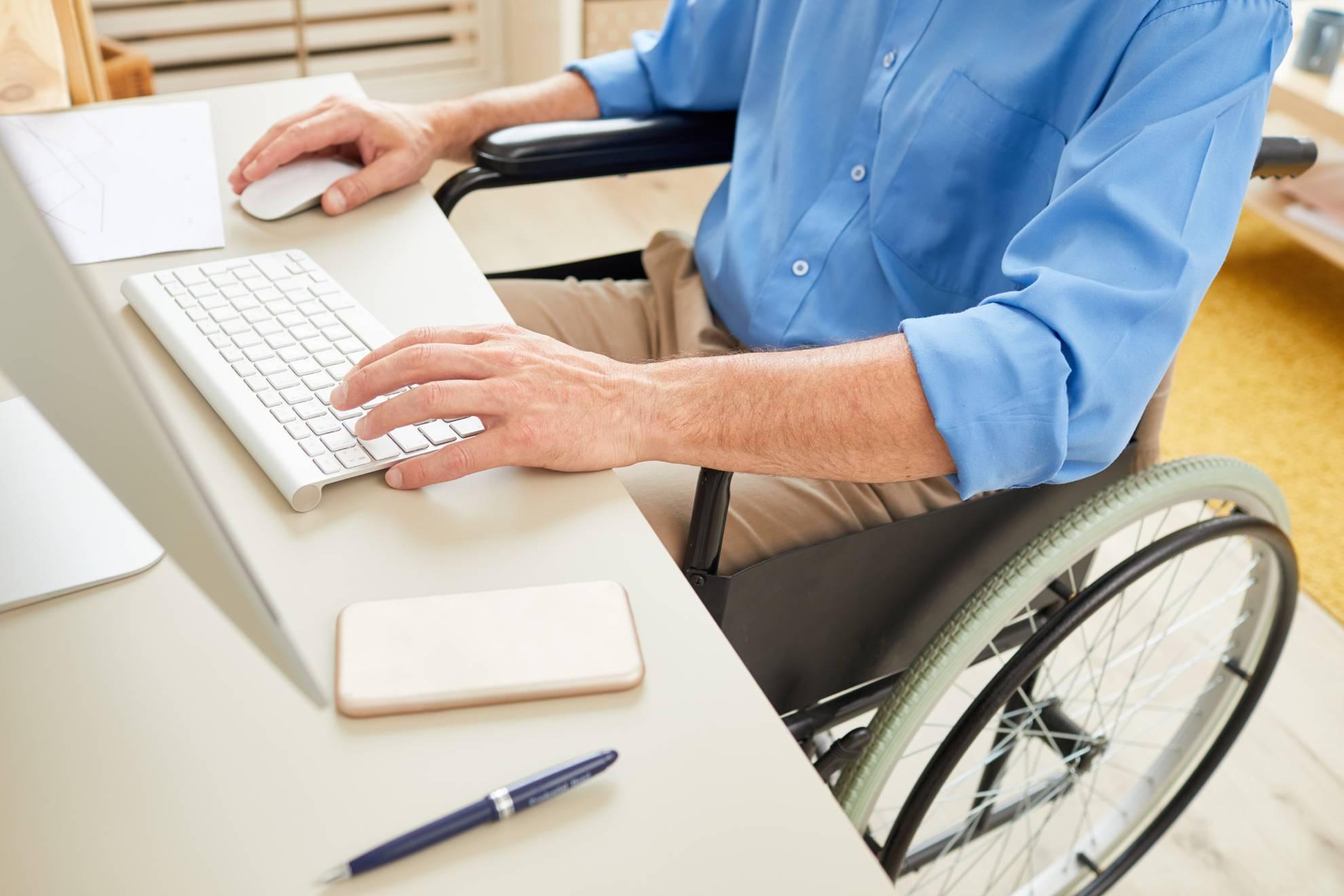 disabled-man-typing-on-computer-VU45AGT (1)