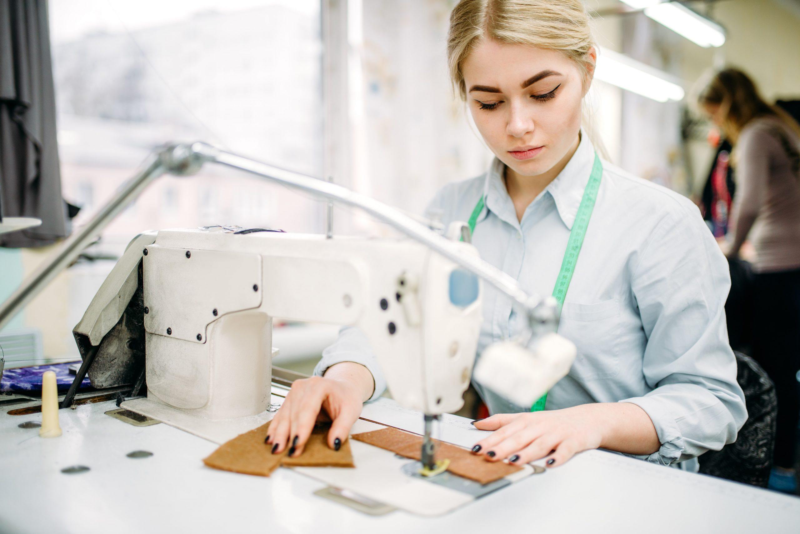 needlewoman-sews-fabrics-on-a-sewing-machine-PBPZL63-min