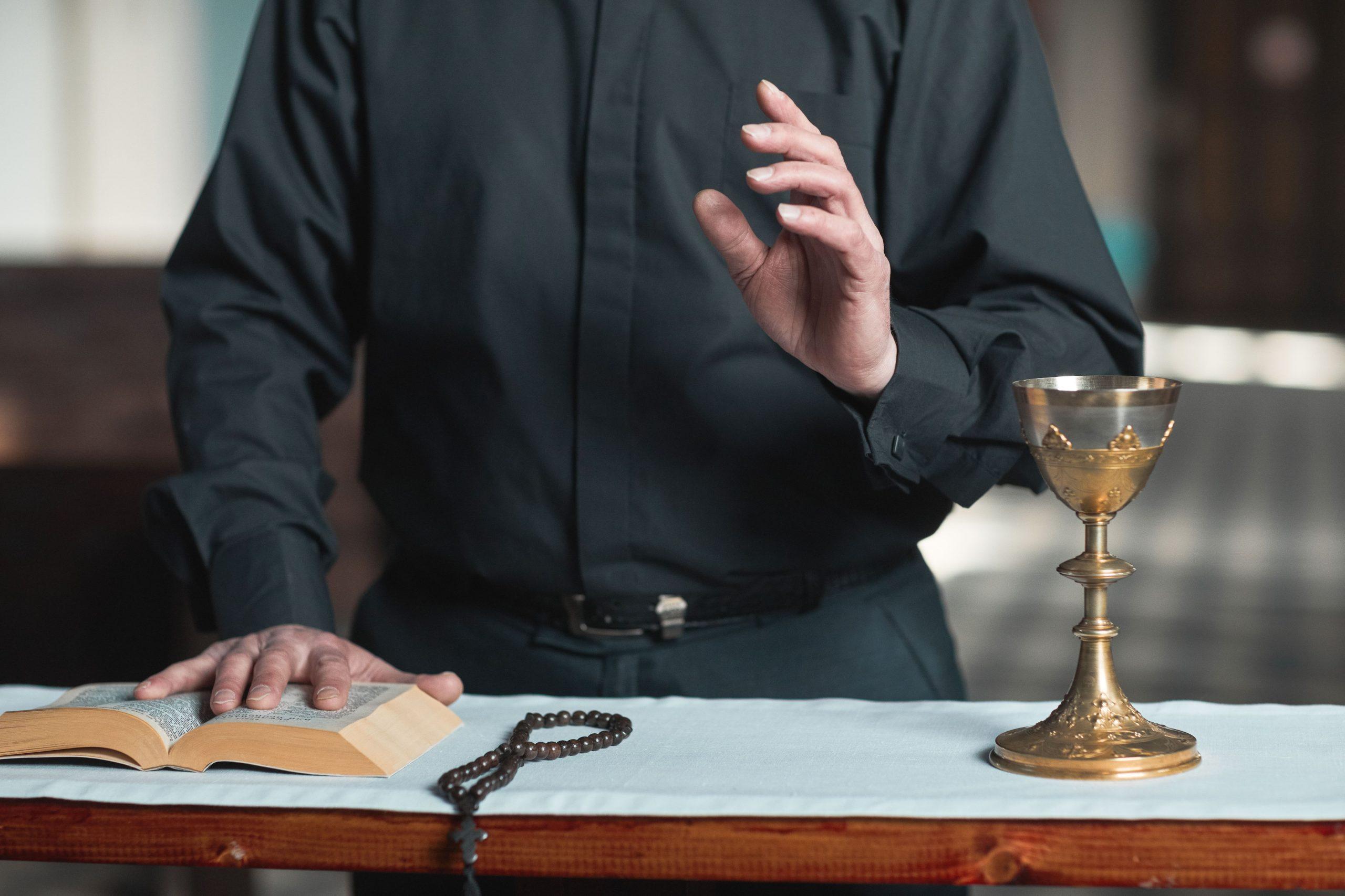 priest-at-the-altar-QU2LTPJ