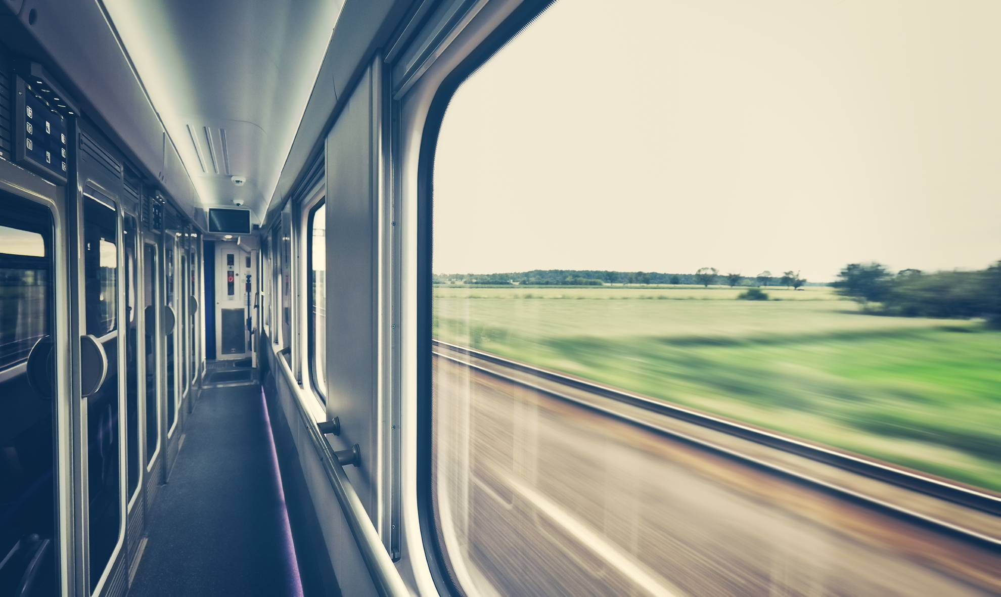 retro-toned-window-of-a-train-in-motion-PBM9ZKL (1)
