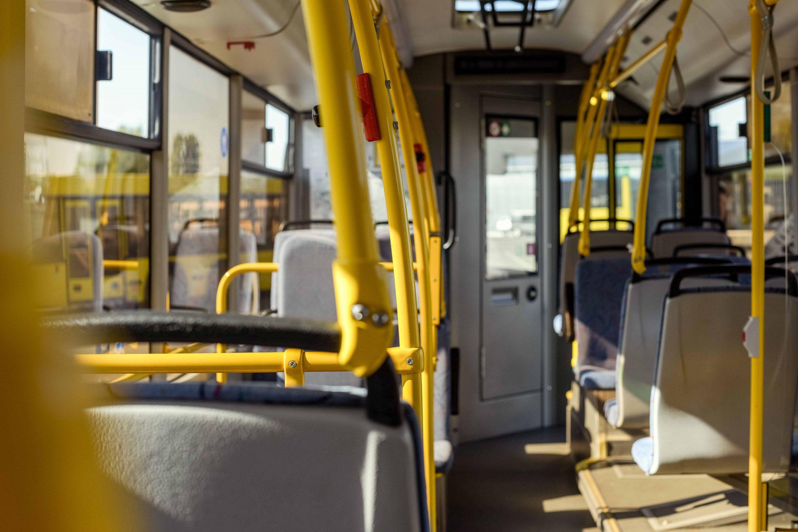 selective-focus-of-empty-city-bus-interior-with-se-YF57WWQ-min
