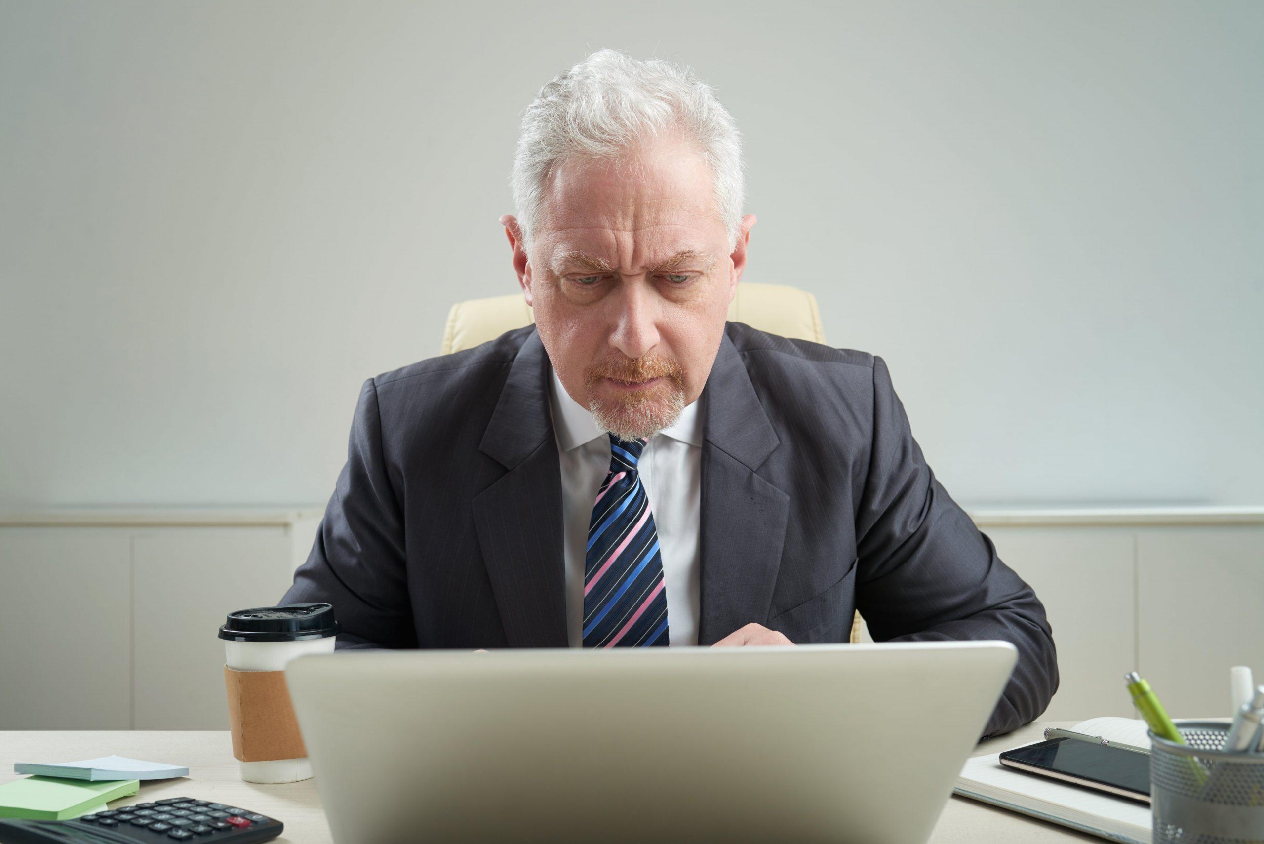 senior-businessman-at-workplace-ZTJZ7ET-min