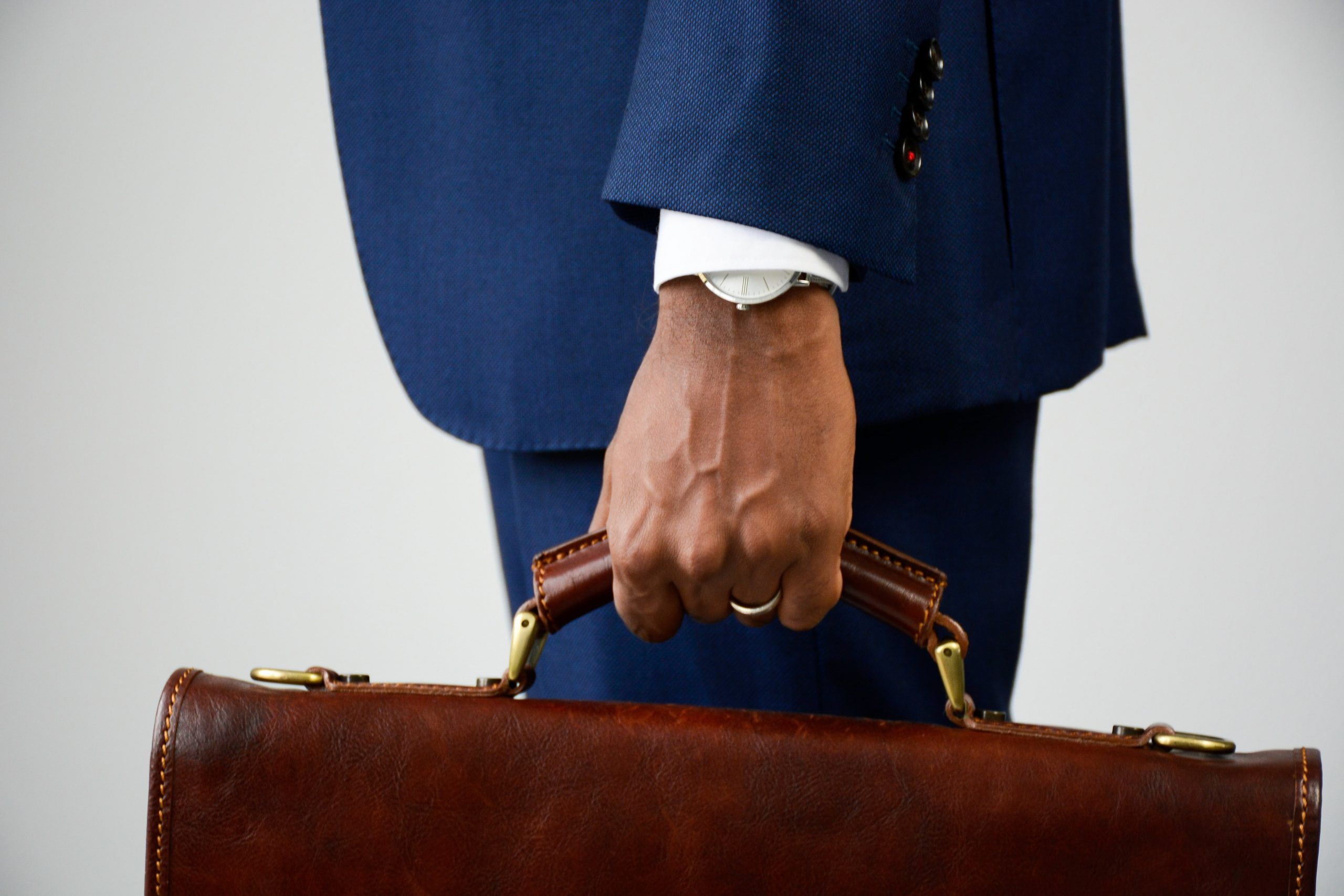 close-up-of-stylish-young-businessman-in-blue-form-PRJPREG-min