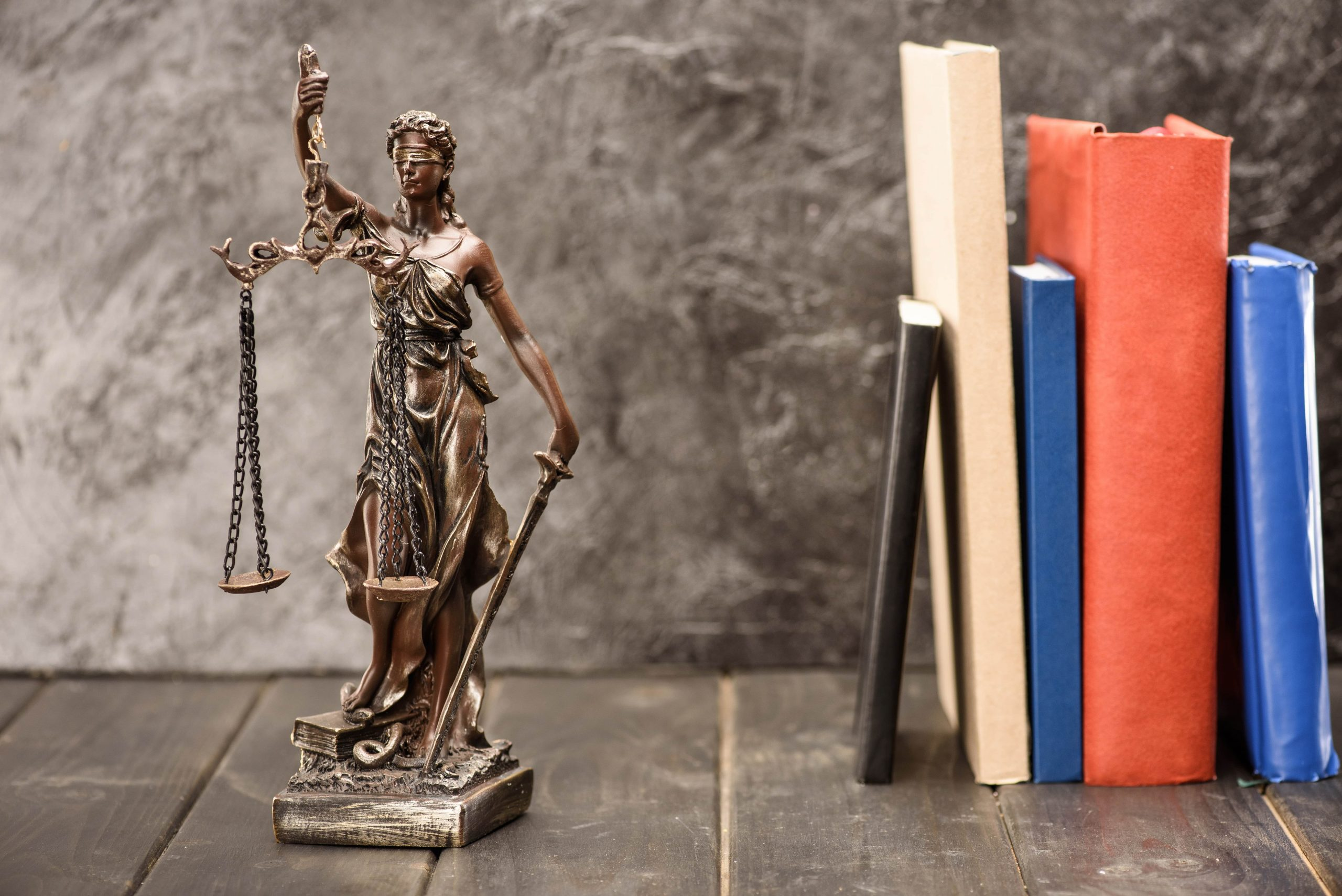 close-up-view-of-antique-statue-of-lady-justice-an-M2YCLMN-min