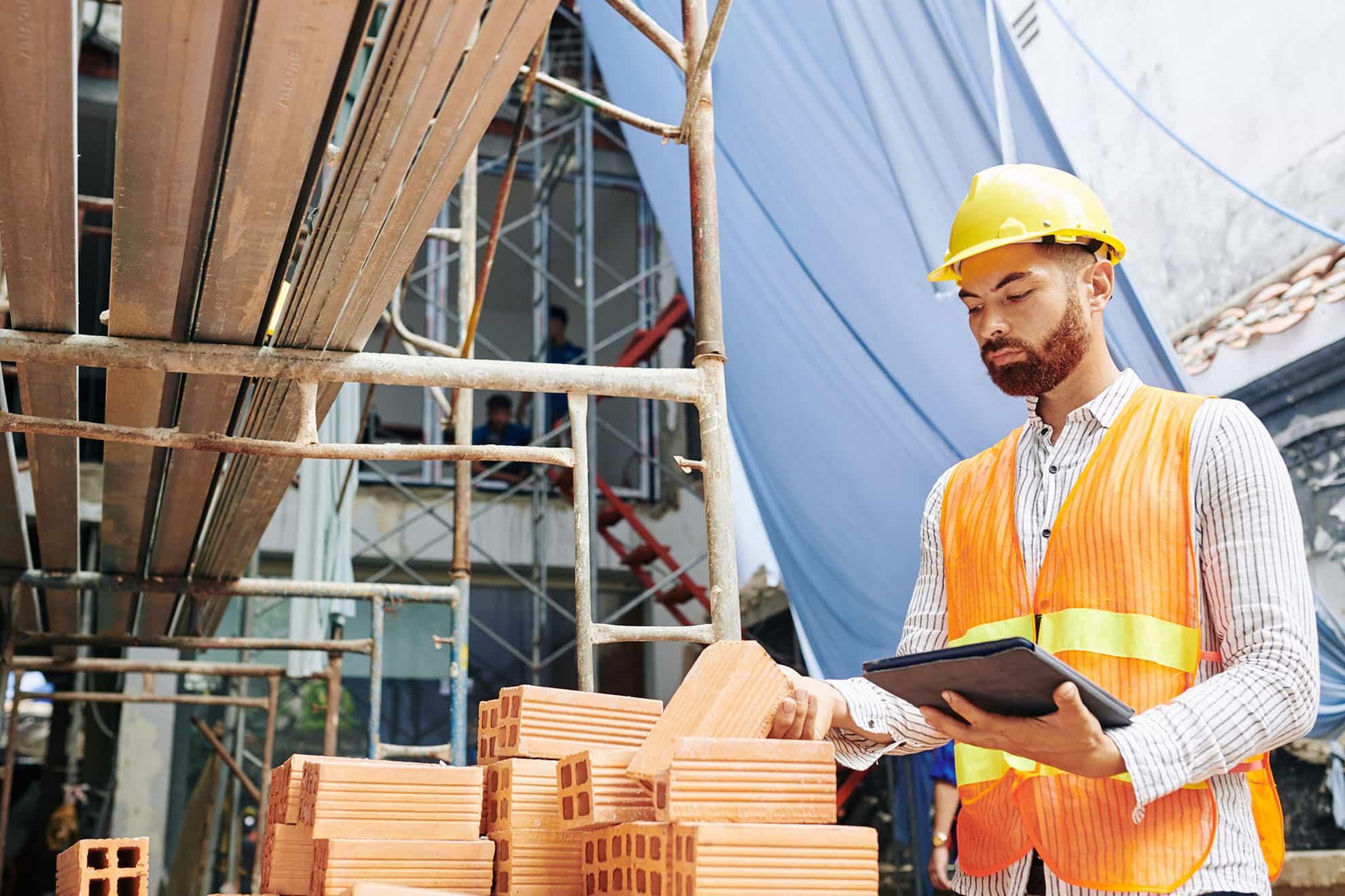 contractor-checking-bricks-N8MF5K9-min