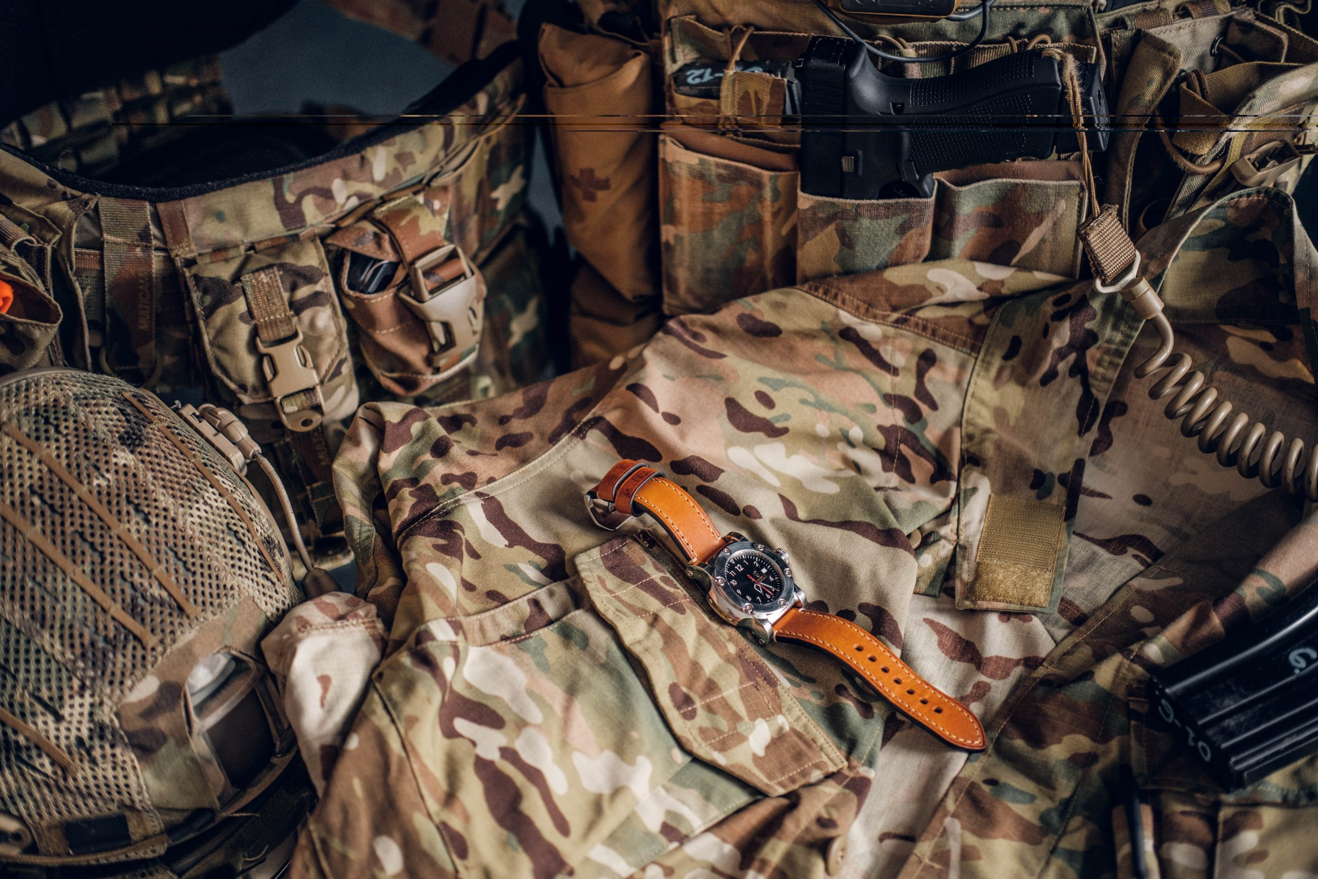 nice-watch-with-military-uniform-on-the-table-GZLPYH3