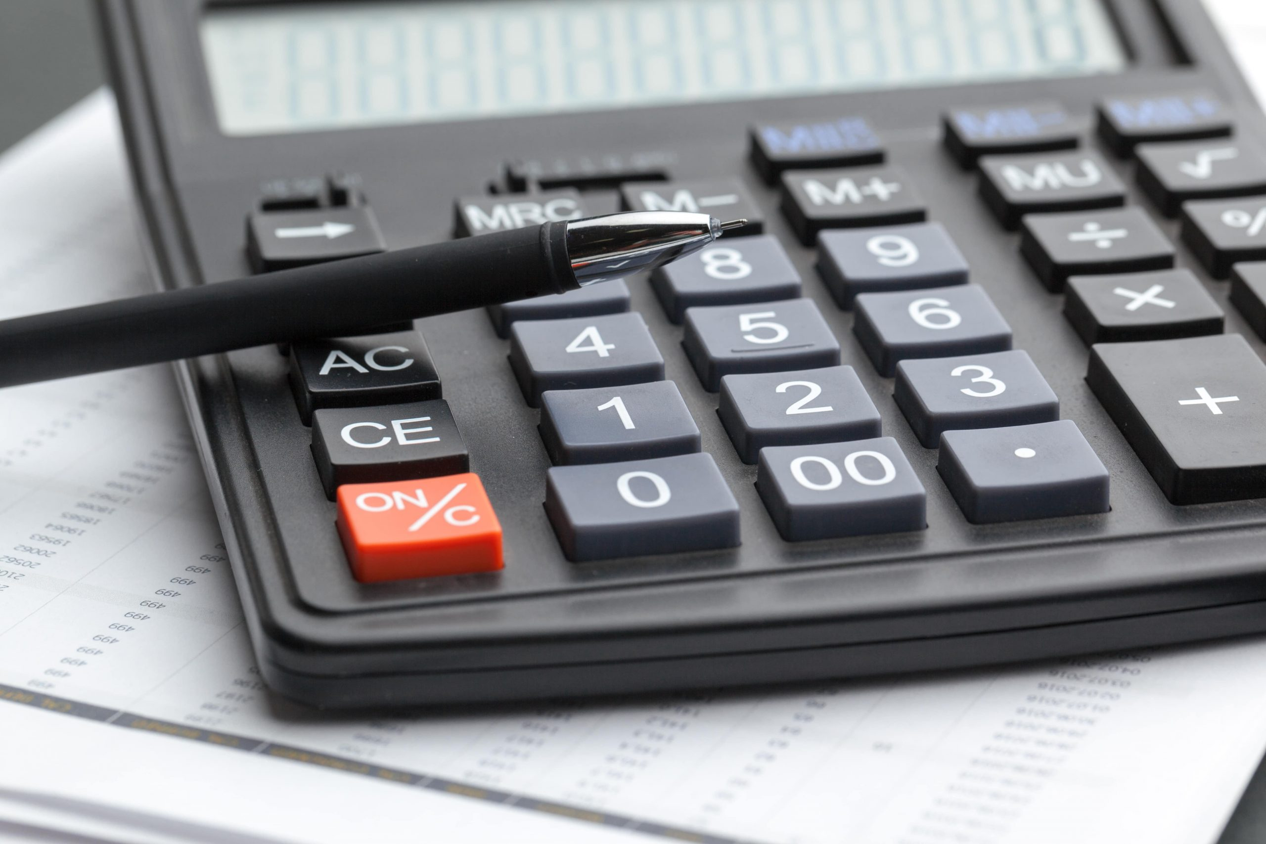 office-table-calculator-with-pen-close-up-QKZE86M
