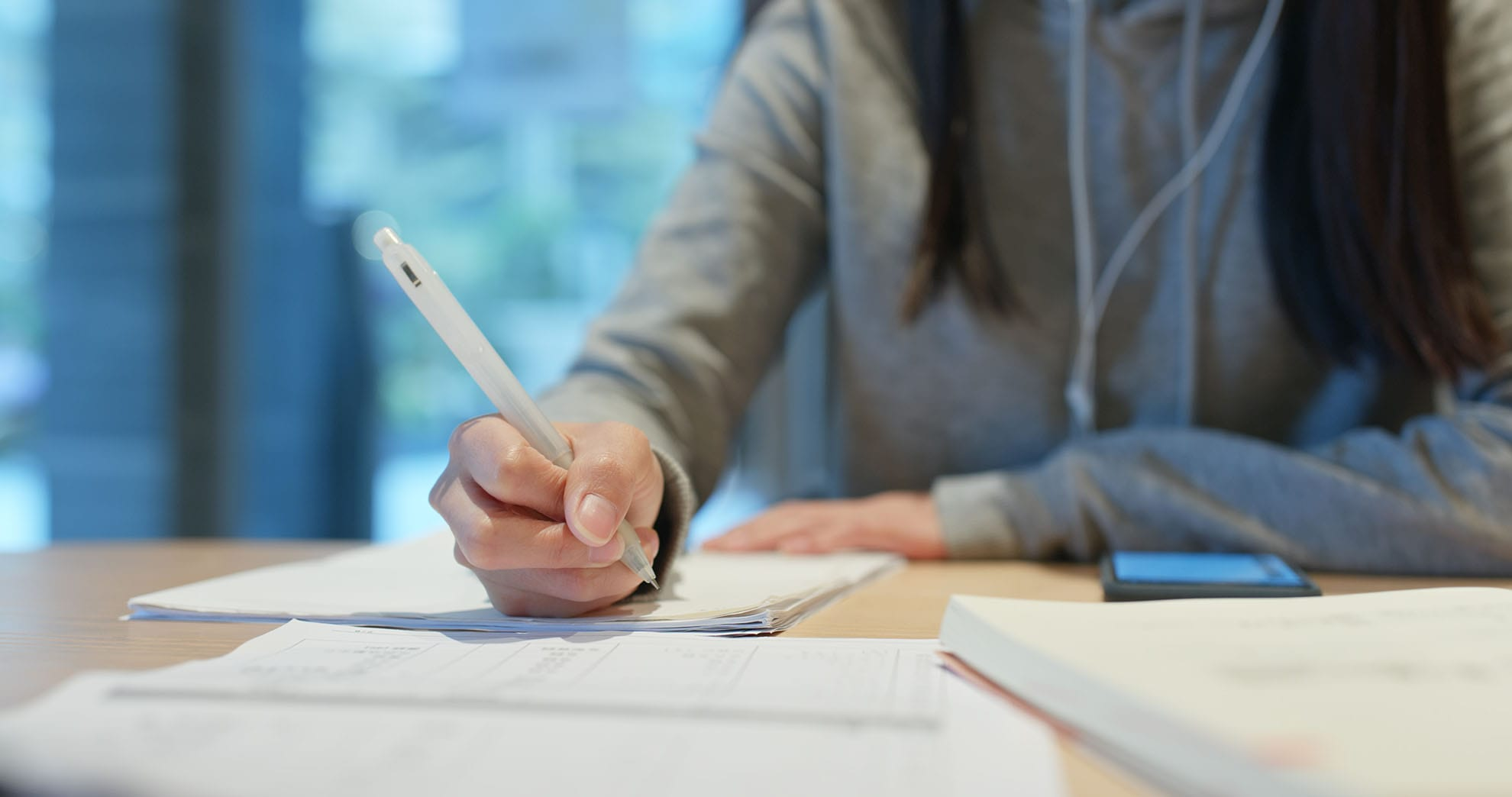 woman-study-the-note-on-paper-at-library-YH6E8LF-min